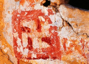 8. Bon swastika and the Tibetan letter 'A' painted in various shades of red ochre and white